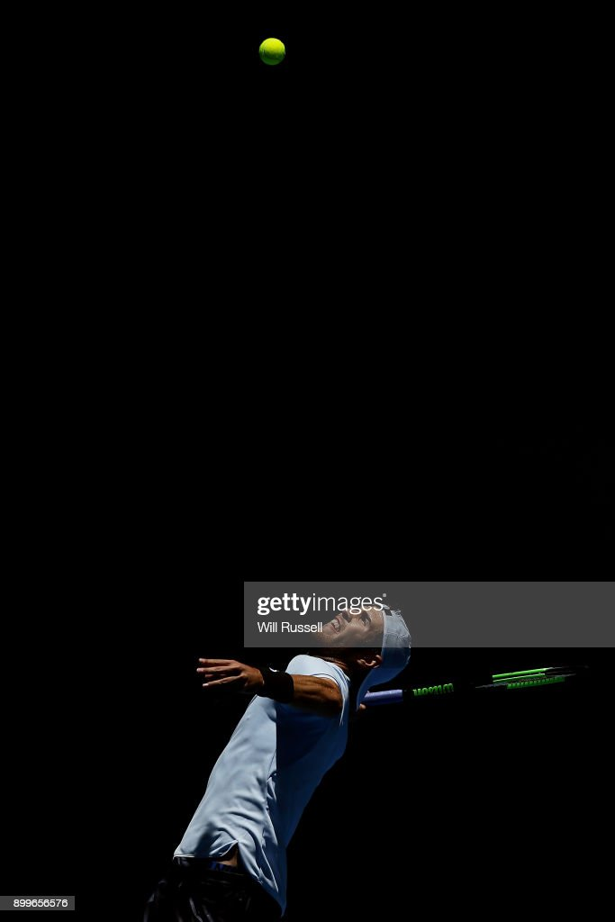 Karen Khachanov of Russia serves to Jack Sock of the United States in the mens singles match on day One of the 2018 Hopman Cup at Perth Arena on December 30, 2017 in Perth, Australia.