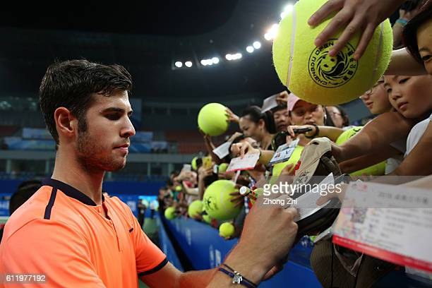 Karen Khachanov of Russia signs autograph for fans after winning the singles final match against Albert RamosVinolas of Spain on Day 7 of 2016 ATP...