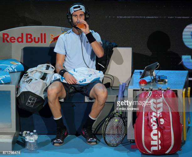 Karen Khachanov of Russia speaks with his coach during time out through the headphones during Day 1 of the Next Gen ATP Finals on November 7 2017 in...