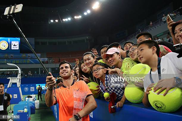 Karen Khachanov of Russia takes selfie with fans after winning the singles final match against Albert RamosVinolas of Spain on Day 7 of 2016 ATP...