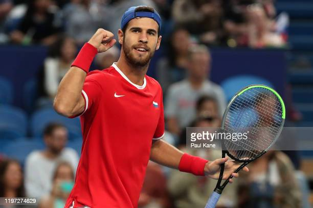 Karen Khachanov of Team Russia celebrates after winning his singles match against Stefano Travaglia of Team Italy during day one of the 2020 ATP Cup...