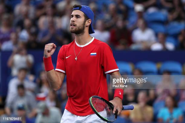 Karen Khachanov of Team Russia celebrates winning the second set in his singles match against Taylor Fritz of Team USA during day three of the 2020...