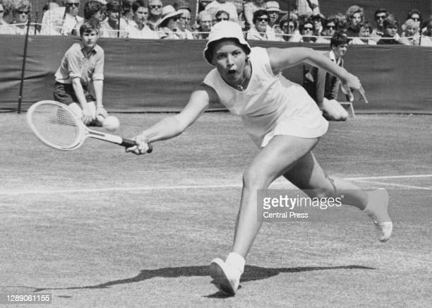 Karen Krantzcke of Australia makes a forehand return to Billie Jean King of the United States during their Women's Singles First Round match at the...