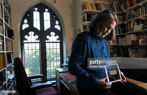 Karen L King Hollis Professor of Divinity at Harvard University in her office with a papyrus fragment of the gospel of Jesus' wife