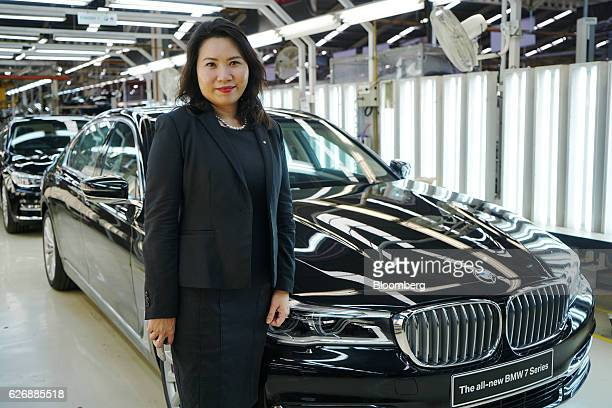 Karen Lim president director of BMW AG Indonesia poses for a photograph next to the company's BMW AG 7Series sedan at a PT Gaya Motor factory in...