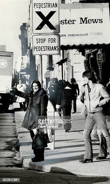 Karen Longlade uses Yonge St. Crosswalk. One reader suggests in letter; that pedesrians activate a flasher before entering crosswalk.