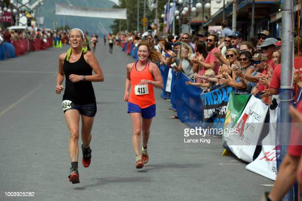 Karen Looney and Cynthia Martensen approach the finish line during the Women's Division of the 91st Running of the Mount Marathon Race on July 4 2018...