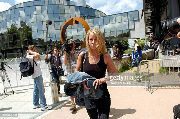 Karen Marchal sister of Dutroux' victim An walks outside the Arlon assize court 17 June 2004 Belgian childrapist Marc Dutroux was convicted on...
