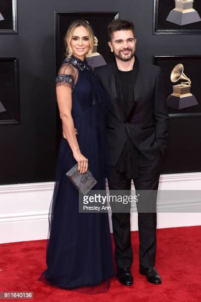 Karen Martinez and Juanes attends the 60th Annual GRAMMY Awards Arrivals at Madison Square Garden on January 28 2018 in New York City