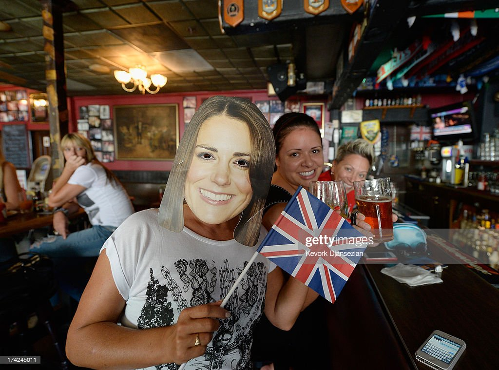 Karen Milne, (L) from Scotland, wears a mask representing Catherine, Duchess of Cambridge, as she and her friends Rachelle Rodriguez (C) and Michelle Lewis (R) celebrate the royal birth announcement at Ye Olde King's Head English Pub July 22, 2013 in Santa Monica, California. The Royal couple had a baby boy who was born at 16.24 BST and weighed 8 pounds, 6 ounces. The child, who is now third in line to the throne, has yet to be named.