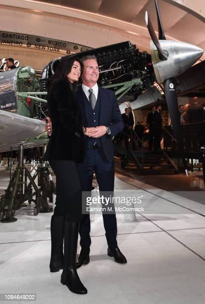 Karen Minier and David Coulthard visit the IWC booth during the Maison's launch of its new Pilot's Watches at the Salon International de la Haute...