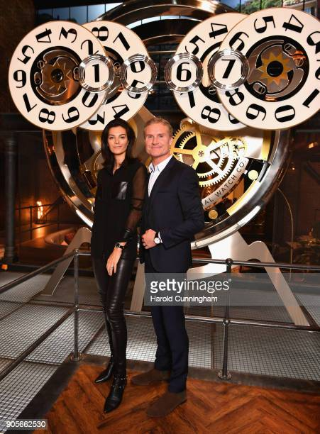 Karen Minier and David Coulthard visit the IWC booth during the Maison's launch of its Jubilee Collection at the Salon International de la Haute...