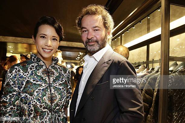 Karen Mok and Remo Raffini President of Moncler attend the opening of the Lee Gardens Moncler store on October 23 2013 in Causeway Bay Hong Kong