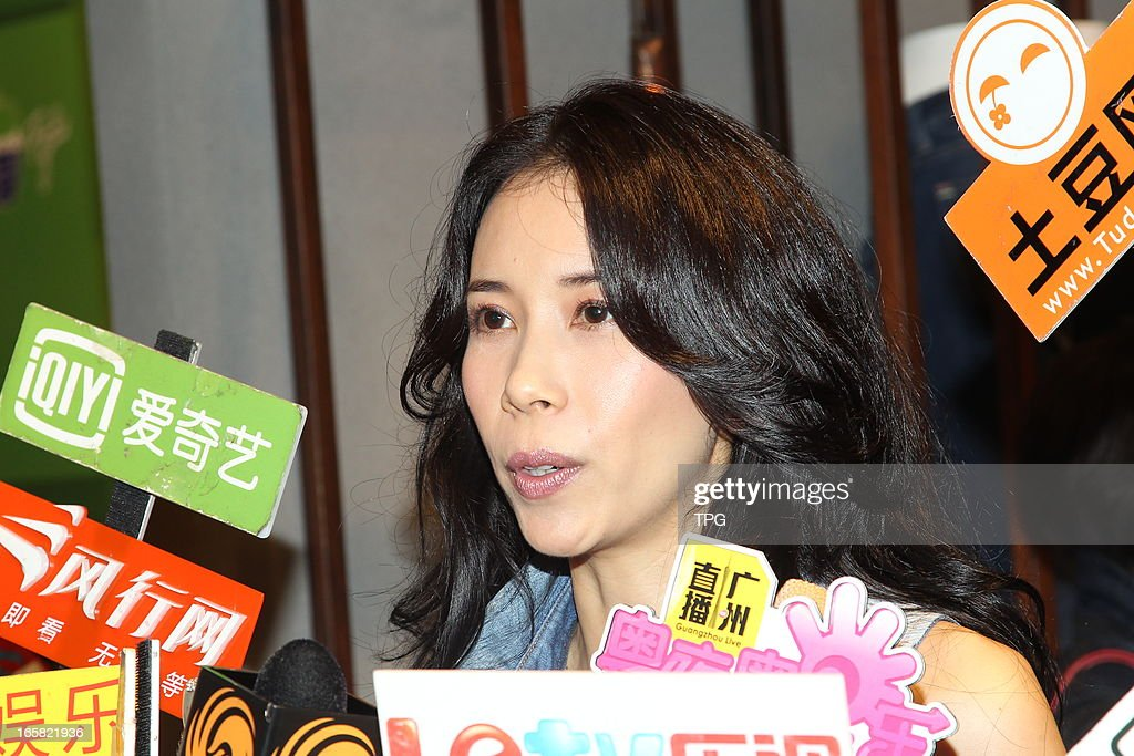 Karen Mok attend Jeans launch press conference in jeans embroidered with 'KAREN MOK' on Friday April 05,2013 in Hong Kong,China.