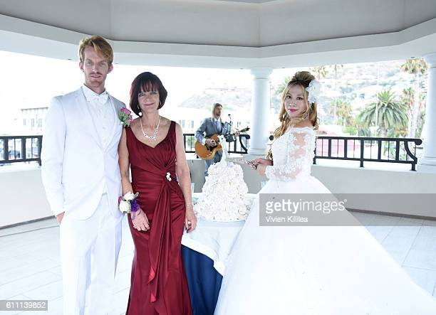 Karen Moore Justin Moore Aoki and Alice Aoki attend the Aoki wedding dessert reception at the Catalina Island Museum on September 25 2016 on Catalina...