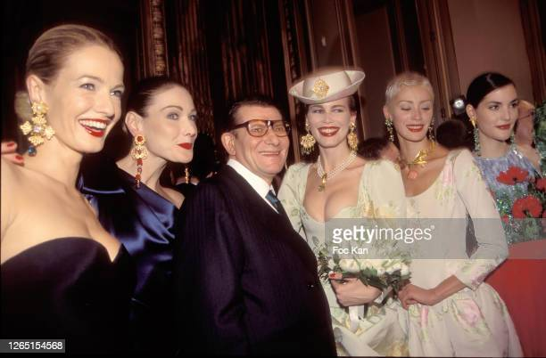 Karen Mulder, Carla Bruni, Yves Saint Laurent and Claudia Schiffer and models attend a Yves Saint Laurent Show during A Paris Fashion Weeks in the...