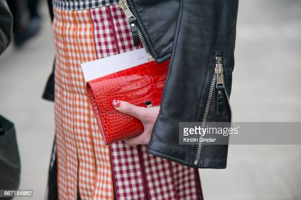 Karen Ng wears a Christopher Kane skirt and Balenciaga jacket on day 4 of London Womens Fashion Week Autumn/Winter 2017 on February 20 2017 in London...