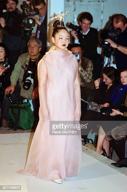 Karen Park Goude the wife of designer JeanPaul Goude models a haute couture pale pink dress with hair ornament designed by French fashion designer...