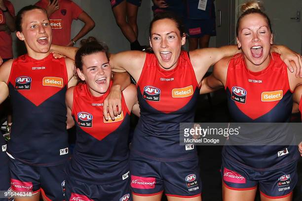 Karen Paxman Lily Mithen and Meg Downie of the Demons sing the club song after winning during the round two AFLW match between the Melbourne Demons...