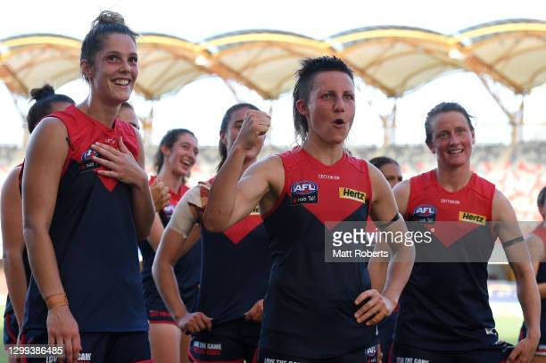 Karen Paxman of the Demons celebrates victory with team mates during the round one AFLW match between the Gold Coast Suns and the Melbourne Demons at...