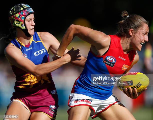 Karen Paxman of the Demons is tackled by Tori GrovesLittle of the Lions during the 2019 NAB AFLW Round 03 match between the Brisbane Lions and the...
