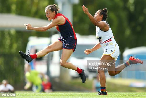 Karen Paxman of the Demons kicks the ball away from Ruth Wallace of the Crows during the round two AFLW match between the Melbourne Demons and the...