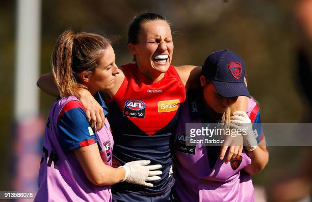 Karen Paxman of the Demons leaves the field injured during the round one AFLW match between the Melbourne Demons and the Greater Western Sydney...