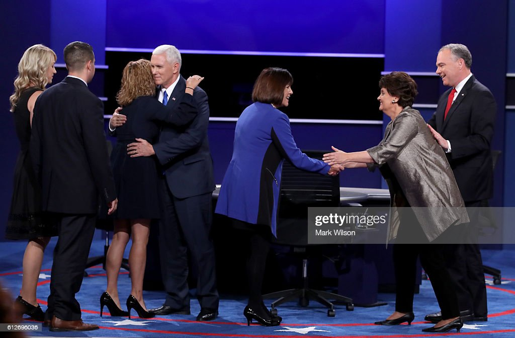 Karen Pence and Anne Holton shake hands after their husbands Republican vice presidential nominee Mike Pence and Democratic vice presidential nominee Tim Kaine, respectively, debate during the Vice Presidential Debate at Longwood University on October 4, 2016 in Farmville, Virginia. This is the second of four debates during the presidential election season and the only debate between the vice presidential candidates.