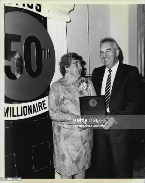 Karen Pini on Behalf of Lotto presented a gold plaque to Mrs Phyllis McGregor at the intercontinental Phillip St City May 22 1986