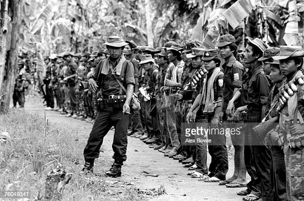 Karen rebels formup before probing Burmese Army positions close to the Karen's headquarters at Maw Pokay in eastern Burma 26th March 1984 The Karen...