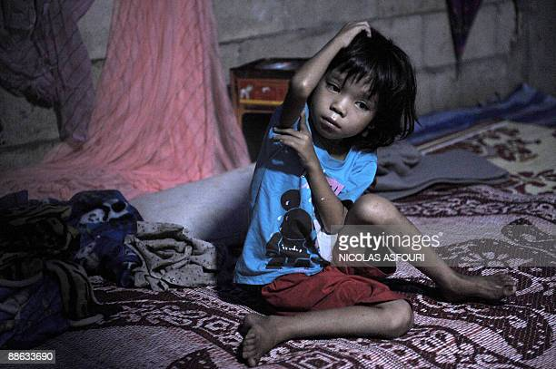 STORY 'THAILANDMYANMARRIGHTSUNRESTETHNICKAREN' A Karen refugee orphan girl sits inside a temporary shelter used as a school and dormitory at the Safe...