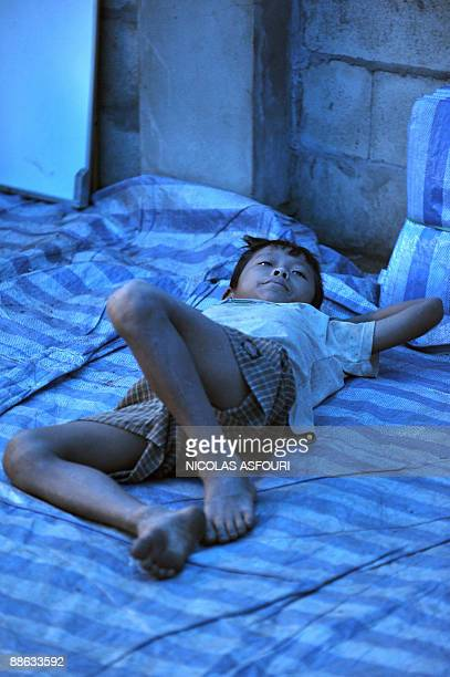 STORY 'THAILANDMYANMARRIGHTSUNRESTETHNICKAREN' A Karen refugee orphan rests inside a temporary shelter used as school and dormitory on the...