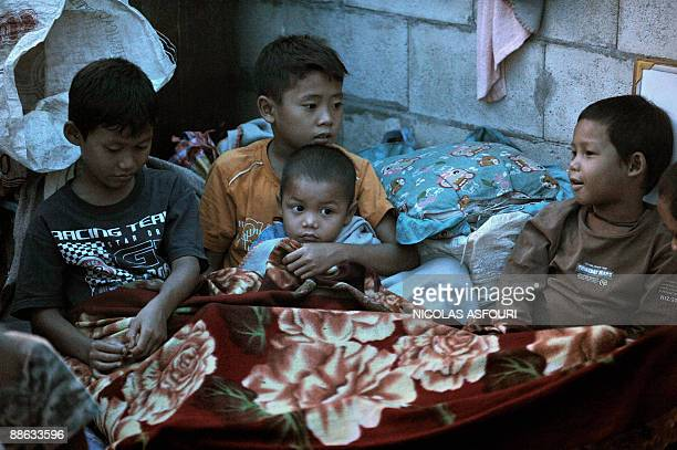STORY 'THAILANDMYANMARRIGHTSUNRESTETHNICKAREN' Karen refugee orphans rest inside a temporary shelter used as a school and dormitory at the Safe Haven...