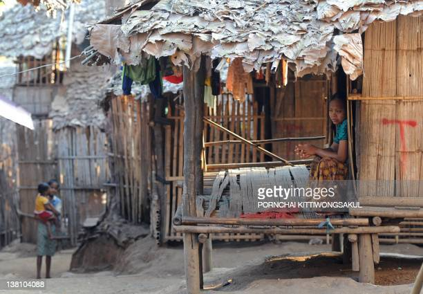 A Karen refugee sits in her shelter at Mae La refugee camp in Mae Sot near the ThaiMyanmar border on January 29 2012 More than 140000 refugees have...