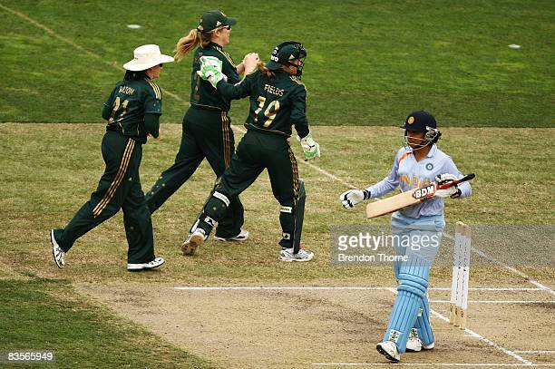 Karen Rolton Alex Blackwell and Jodie Fields of Australia celebrate after claiming the wicket of Anjum Chopra of India during the third women`s one...