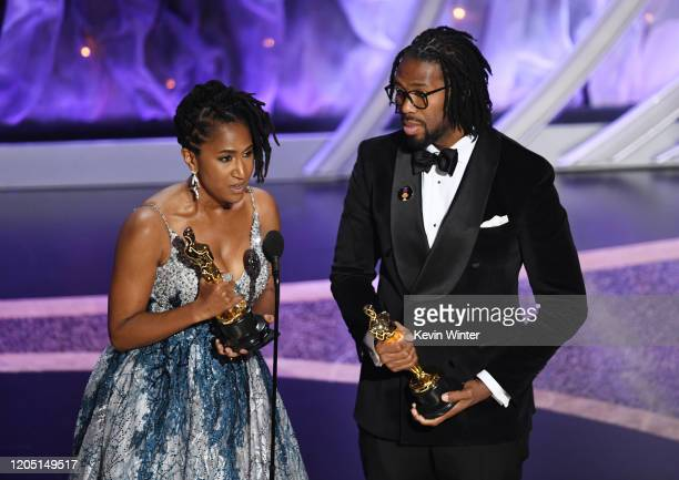 Karen Rupert Toliver and Matthew A Cherry accept the Animated Short Film award for 'Hair Love' onstage during the 92nd Annual Academy Awards at Dolby...
