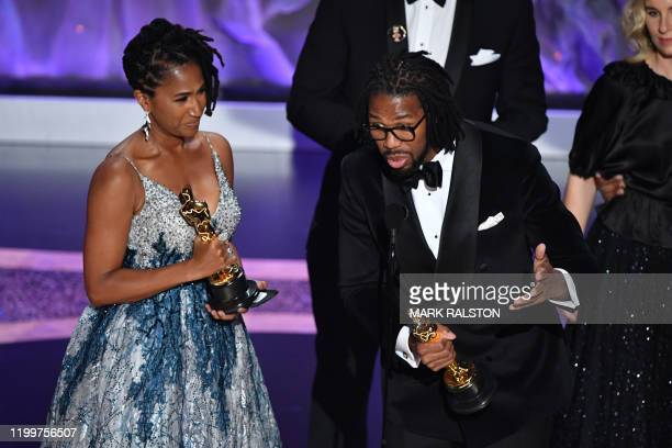 """Karen Rupert Toliver and US director Matthew A. Cherry accept the award for Best Animated Short Film for """"Hair Love"""" onstage during the 92nd Oscars..."""
