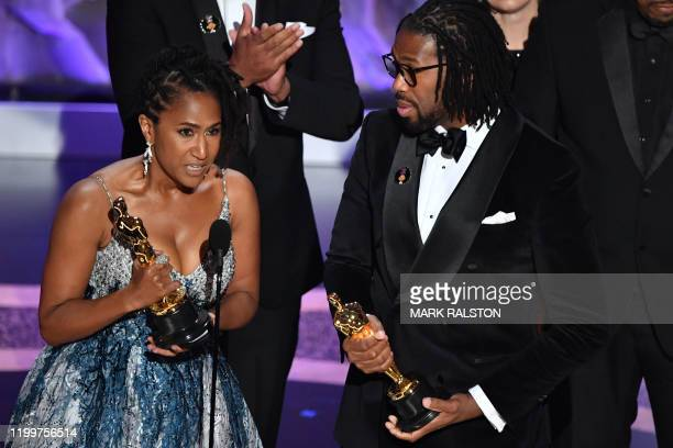 Karen Rupert Toliver and US director Matthew A Cherry accept the award for Best Animated Short Film for Hair Love onstage during the 92nd Oscars at...