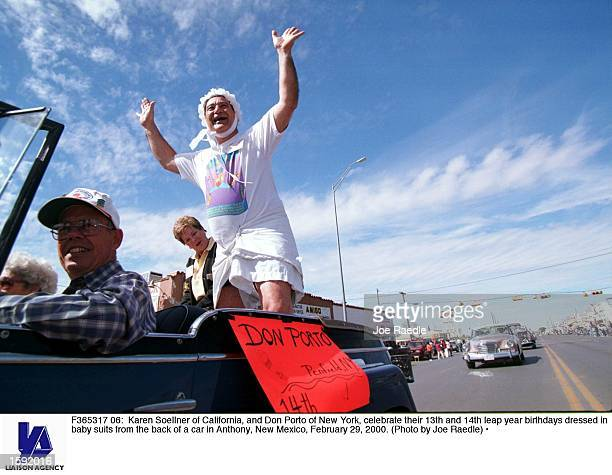 Karen Soellner of California and Don Porto of New York celebrate their 13th and 14th leap year birthdays dressed in baby suits from the back of a car...