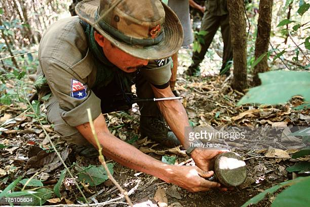 Karen soldiers are removing landmines planted by their own people on a jungle path to dissuade the Burmese army from going ahead