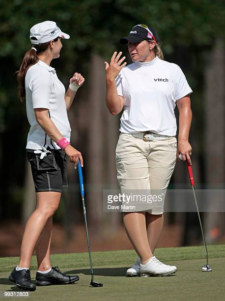 Karen Stupples of England talks with Paige Mackenzie on the 18th green during second round play in the Bell Micro LPGA Classic at the Magnolia Grove...