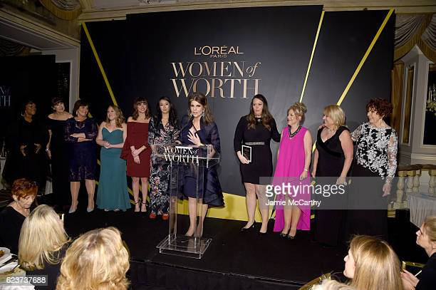 Karen T Fondu poses backstage with 2016 Honorees at the L'Oreal Paris Women of Worth Celebration 2016 on November 16 2016 in New York City