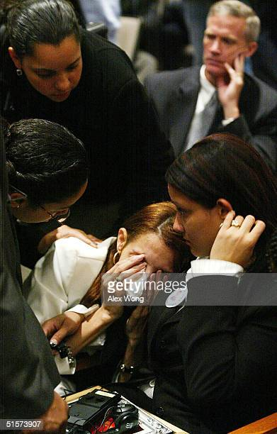 Karen Tavarez whose mother and nephew were killed at the crash of American Airlines flight 587 is comforted by her sister Cindy and others during a...