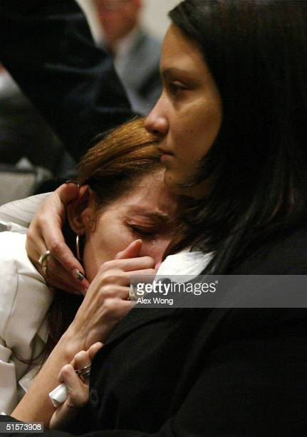 Karen Tavarez whose mother and nephew were killed at the crash of American Airlines flight 587 is comforted by her sister Cindy during a meeting to...