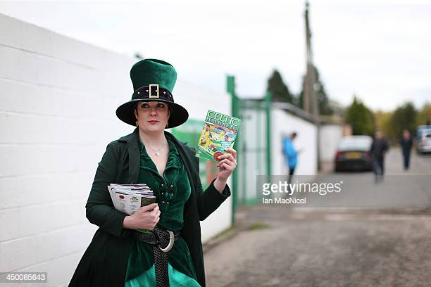 CARLISLE ENGLAND NOVEMBER 16 Karen the offical Celtic Nation mascot sells programmes during the Ebac Division One football match between Celtic...