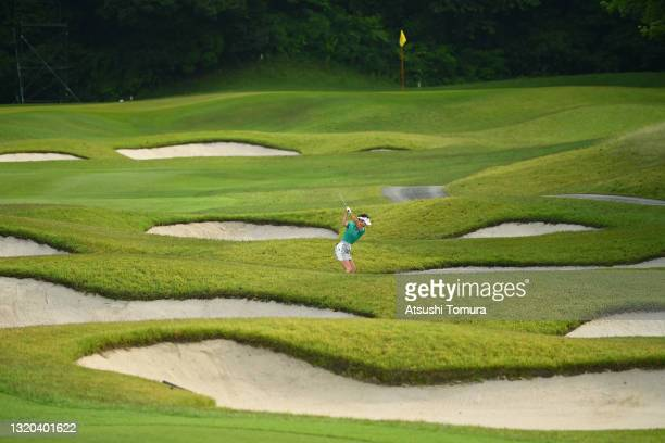 Karen Tsuruoka of Japan hits her second shot on the 6th hole during the rest of first round of the Resorttrust Ladies at St. Creek Golf Club on May...