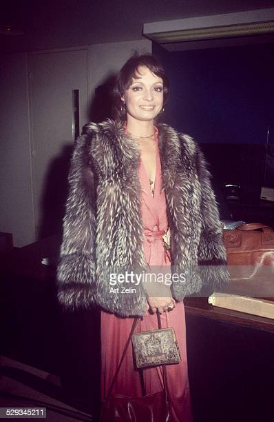Karen Valentine wearing a fur coat and rose formal dress circa 1970 New York