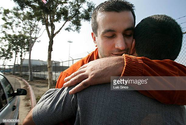 Karen Vanian hugs his brother Armen Vahanyn outside the Immigration and Customs Enforcement detention facility on Terminal Island A native of Armenia...