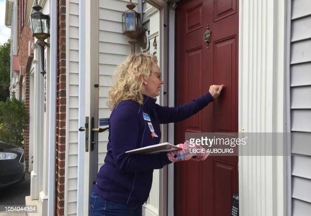 Karen Vaught who belongs to the organization advocating for stronger gun laws Moms Demand Action knocks on doors hoping to help flip control of...