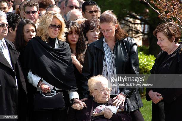 Karen Vitale with daughters Dawn Marie Stefanie and Michelle holds hands with her motherinlaw Antoinette Vitale as the coffin of her husband retired...